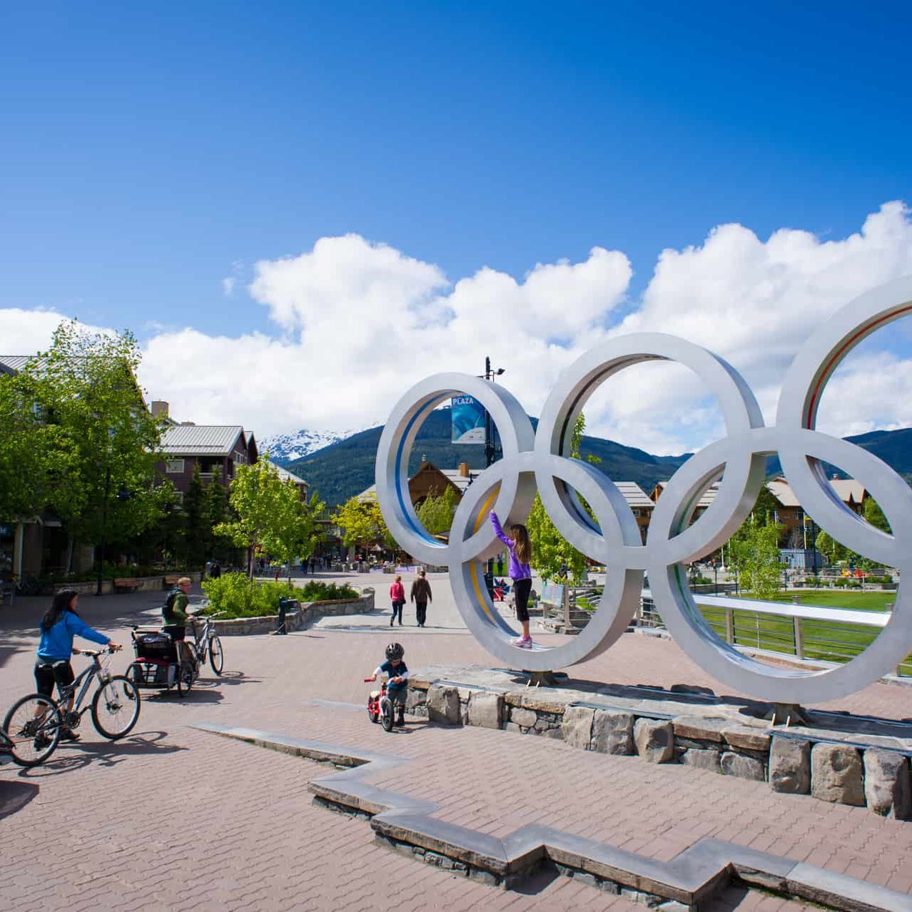 Family stroll past the Olympic rings at Celebration Plaza
